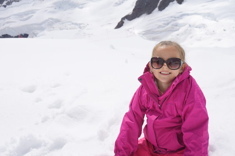 Child in the snow at the Jungfraujoch